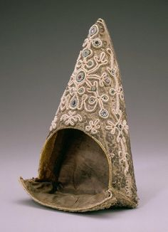 Kokoshnik Object name: Headgear Made from: Silk, linen, cotton, gold plate thread, gold-wrapped silk thread, silver-wrapped silk thread, seed pearls, turquoise-colored stones, colored pastes Made in: RUSSIA: Kostroma Province Date made: Late 18th c.-Early 19th c.