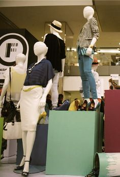 Display of clothing from various designers