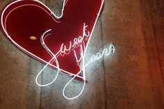 'Sweet years' Neon in a store by Architect Selina Bertola