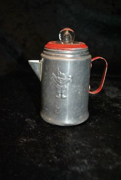 VINTAGE TIN TOY COFFEE POT WITH REAL GLASS KNOB (I just bought one like this but without the glass knob, for $4)