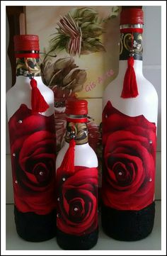 Spray painted with primer, then acrylic paint w/crackle medium and decoupage w/paper roses. Could use napkins or scrapbook paper. The possibilities are endless. Recycled Glass Bottles, Glass Bottle Crafts, Wine Bottle Art, Painted Wine Bottles, Diy Bottle, Painted Wine Glasses, Bottles And Jars, Decorative Bottles, Altered Bottles