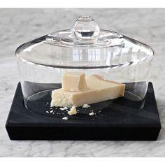 Glassklokken Doumo, med solid fundament av oljet eik, passer godt til å vise frem dine favoritt-ting i. Den staselige klokken er designet av InspireBy.