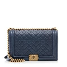 An iconic Chanel shoulder bag in quilted navy blue caviar leather with antique gold-tone hardware. Details include a modern CC turnlock and chunky chain and leather strap. Wear this style with the straps doubled-over or extended.