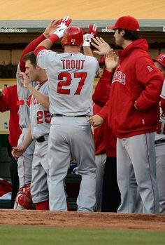 Game #44 5/22/12: Mike Trout #25 of the Los Angeles Angels of Anaheim is congratulated by teammates after scoring on a sacrifice fly in the first inning against the Oakland Athletics at O.co Coliseum on May 22, 2012 in Oakland, California. (Photo by Thearon W. Henderson/Getty Images)
