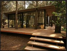 Deck accommodates trees. Roof extends for partial covered deck