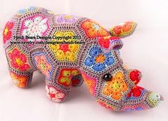 Thandi the African Flower Rhino crochet pattern: http://www.ravelry.com/patterns/library/thandi-the-african-flower-rhino-crochet-pattern by Heidi Bears Designs