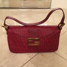 Red Fendi Baguette Bag NWOT I got this as a gift from my family. Never used it and it's not rally my style so selling it off finally. I am not sure what style bag this is or how much they bought it for. Open to reasonable offers. It's in immaculate condition. FENDI Bags