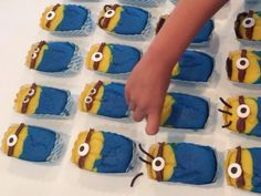 Decorate the Despicable Me minion cupcakes with candy eyes and licorice for the hair- your birthday kid can do this
