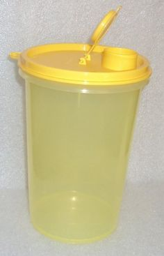 Tupperware MEGA 36 oz BEVERAGE TUMBLER Yellow by Tupperware. $16.99. Dishwasher safe. Mega tumbler with flip-top cap. Cool, fresh lemon yellow in color. Drink spout and cap, virtually airtight, liquid-tight. Tupperware 36 ounce Handolier Beverage Container. 1 Tupperware Mega Tumbler in cool, fresh lemon yellow color.  Holds about 36 ounces.  Drinking spout and flip top cap are virtually airtight, liquid-tight.  Formerly called a Tupperware Handolier Beverage Container.  ...