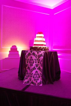 Chic cake with accent pink uplighting!  #diy #rentmywedding #wedding #uplighting #diywedding #weddingideas #weddinginspiration #ideas #inspiration #celebration #weddingreception #party #weddingplanner #event #planning #dreamwedding