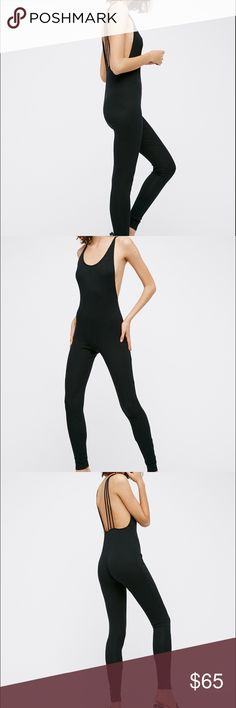 FREE PEOPLE SLIM FIT JUMPSUIT NWT SIZE M Perfect for layering, this soft and stretchy bodysuit features a ribbed fabrication and a slim fit.   *By Intimately *94% Cotton *6% Spandex *Machine Wash Cold *Import  Measurements for size: Small *Waist: 26.0 = 66.0 *Rise: 18.8 = 47.6 *Inseam: 30.2 = 76.8 Free People Pants Jumpsuits & Rompers
