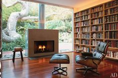 #Eames lounge chair + fireplace + books = nirvana.