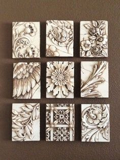 A selection of monochromatic Sid Dickens memory tiles create a beautiful decorative feature on the wall. These are actually really neat idea.