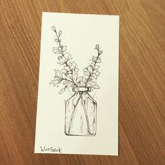 """I would do a cracked vase that has wild flowers in it with the quote """" a wild flower can never be contained"""""""