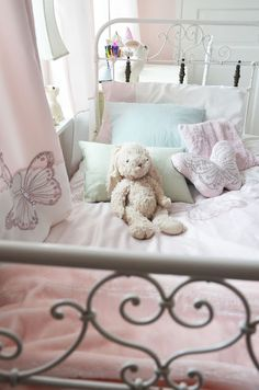 Soft pink girlie bedroom, iron bed frame