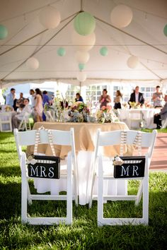 "Relaxed chair decor idea - chalkboard ""Mrs"" + ""Mr"" signs with striped ribbon {Casey Durgin Photography}"