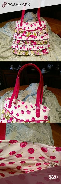 Vera Bradley floral ruffled lady purse Small adorable floral cloth and hot pink vinyl handled mini purse. New without tags. 100% clean inside and out. Zipper still enclosed in paper cover. Great for spring flings or a warm weather getaway. Vera Bradley Bags Mini Bags