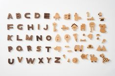 The entire family will love this ingenious, adorable alphabet block set created by Korean designers Oioiooi. This unique play set consists of 60 solid wooden blocks made of walnut and beech wood. Each wooden letter has a corresponding shape for children to identify and match as they play. In addition to supporting letter recognition, these alphabet blocks also inspire storytelling and imaginative play. The included picture book, storage bag, and sturdy drawer box makes this Alphabet Play… Alphabet Blocks, Wooden Alphabet, Wooden Letters, Name Puzzle, Letter Recognition, Montessori Toys, Block Lettering, Wooden Blocks, Wood Toys