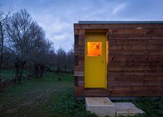 Four Seasons House by Churtichaga + Quadra-Salcedo built in a meadow Yellow door <3