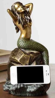 Mermaid Cell Phone Holder with Bluetooth Speaker  $99.95 mermaidhomedecor.com - Mermaid Home Decor