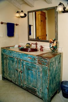 Cypress Building Contractor's Valley View remodel eclectic bathroom featuring Native Trails hand hammered copper sink