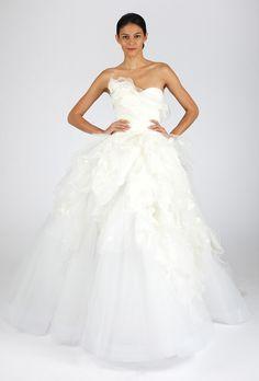 Brides.com: . Strapless ball gown wedding dress with ruffled sweetheart neckline and flowing skirt, Oscar de la Renta  See more Oscar de la Renta wedding dresses in our gallery.