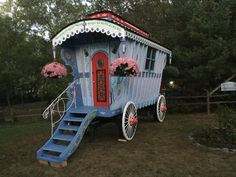 Gypsy Wagon Garden Shed We made this on an old hay wagon: Windows are made from glass plates, cut apart stain glass light fixtures, and bevilled glass pieces from chandeliers that we got from Goodwill or Restore. The candy cane stripes are made from an old baby crib. Large windows were recycled from a neighbor's house. Lots of stenciling. Fake wheels put over the regular tires were made from the ends of spools that held cable.