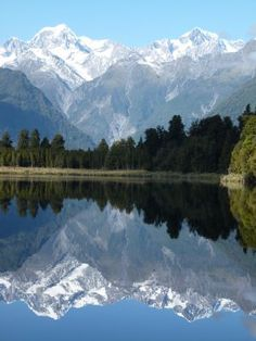 Mount Tasman and Mount Cook, Lake Matheson, New Zealand... I have to visit here.