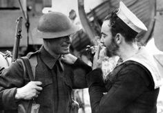 Great photo shared from World War II  Two examples of Britain's war forces, a soldier in battle dress and a bearded Canadian sailor share a light at an English port, on January 14, 1941. (AP Photo)