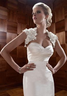Gown features ruched bodice and matching shrug with 3D flowers.