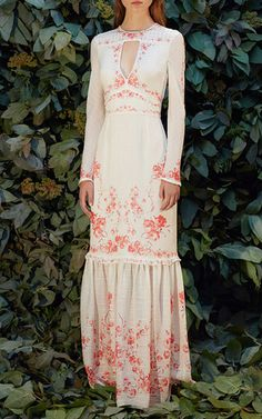 This **Vilshenko** Harley Keyhole Long Sleeve Maxi Dress features a round neckline with keyhole cut out, long sleeves, tiered maxi skirt, and allover floral detail.
