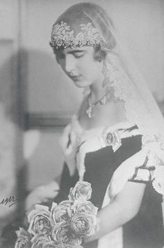 Princess Ingrid of Sweden in her first court dress, which she wore at the royal palace in Stockholm when she made her first appearance at court, ca. 1930.