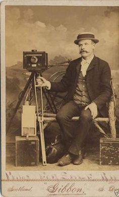 Cameras of 1890 - Albumen Print of Photographer with his Studio Camera on rolling tripod stand. Image circa 1890.