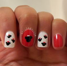 Minnie Mouse silhouettes with bow nail art.