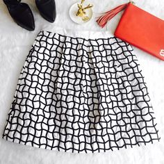 """H&M Black & White Geometric Pattern Skirt Brand new skirt with tags, in perfect condition, & fully lines! True size 12 pleated skirt.                             Measurements taken flat are 15"""" Waist x 19.5"""" in length.                                                                  Please ask if you have any questions. Bundle and Save Please make all offers through the offer button. H&M Skirts A-Line or Full"""