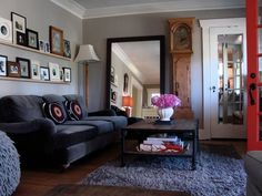 Love the way they display the two rows of frames on the wall behind the couch.