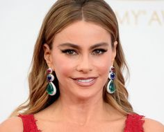 Sofia Vergara in Lorraine Schwartz emerald, sapphire, and ruby earrings at the 2013 Emmy Awards