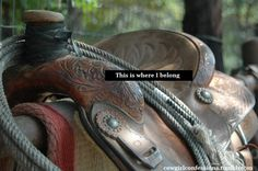 In an old black western saddle and on a lazy Quarter horse. ♥