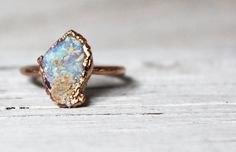 From goth garnets to mermaid opals, here are 25 non-traditional engagement rings that won't break the bank