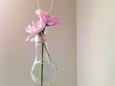 Make a vase from a dead light bulb.