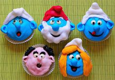 What a great cupcake idea... Some day I've got to make them. I wonder what ingredients  it took to create the faces hats... My favourite on is Papa Smurf.