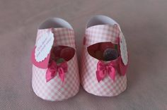 How To Make Paper Baby Shoe Favors:    To create these shoe favors, all you need are scissors, glue, paper, embellishments, and some good cutting skills. That's it!    Tutorial & Download Template @  http://catchmyparty.com/blog/diy-how-to-make-paper-baby-shoe-favors