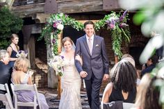 real weddings, outdoor weddings, wedding photography ideas, bride and groom, happy couple, just married, arbor, ceremony, ceremony flowers, greenery, The Historic Brookstown Inn, Winston Salem