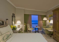 Deluxe room with balcony featuring king size bed