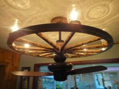 """Created with authentic Amish wagon wheels from Ohio with 6 mason jar lights and 36"""" ceiling fan."""