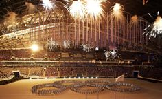 Fireworks light up the arena as artists make a formation in the shape of the Olympic Rings during the closing ceremony of the 2014 Winter Olympics, Sunday, Feb. 23, 2014, in Sochi, Russia. (AP Photo/Gregorio Borgia)