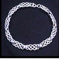 """Vintage Irish Celtic Knot Sterling Link Bracelet This bracelet is a magical beauty that will beguile you with its glamorous style. It features the ancient Irish Celtic knot design on each bracelet link. It has a lobster clasp lock and the backside of each bracelet link is stamped """".925"""" it is an amazing bracelet that will be a favorite and a wardrobe staple Vintage Jewelry Bracelets"""