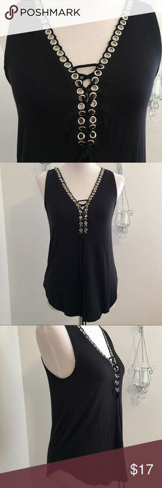 New Black Lace Up Tank Size Small New with tag! Soooo cute! Awesome silver rings allow ya u to lace up this pretty tank. How much you shoe is up to you! Soft and stretchy! 95% rayon 5% Spandex. Cute with jeans and boots💪🏻 Darling Blue Tops Tank Tops