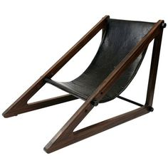 Handsome Rosewood Brazilian Sling Chair Brazilian 1960's Phenomenal Brazilian sling chair circa mid 1960's. Features thick solid rosewood angular frame with black leather sling. Reminiscent of the 'Mies' chair by Archizoom this chair has incredible yet simple lines.