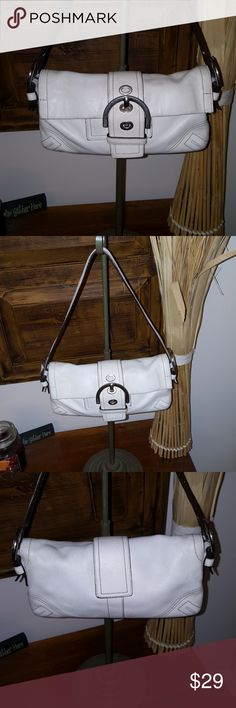 Adorable little Coach purse Well loved condition. Winter white leather with small strap, silver buckle snap on front. Small interior zipper compartment. Shows signs of use, yet a lot of life remaining. Great size and good look.  Shoulder strap is approx 25 inches. Coach Bags Mini Bags
